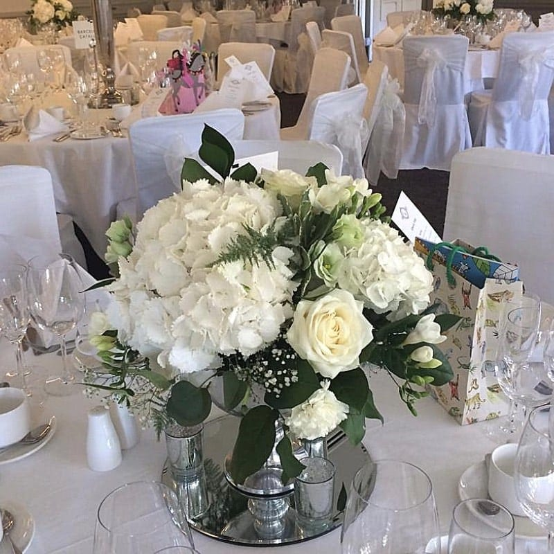 Wedding White Table Arrangement At Venue